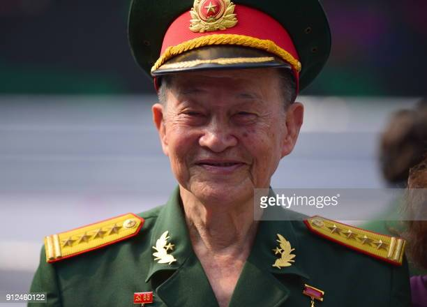 Tet Offensive veteran Col Nguyen Van Tau arrives to attend a ceremony marking the 50th anniversary of the military assault in Ho Chi Minh City on...
