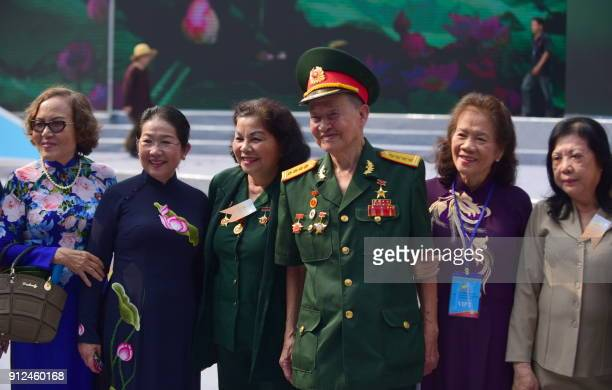 Tet Offensive veteran Col Nguyen Van Tau poses with other veterans as they attend a ceremony marking the 50th anniversary of the military assault in...