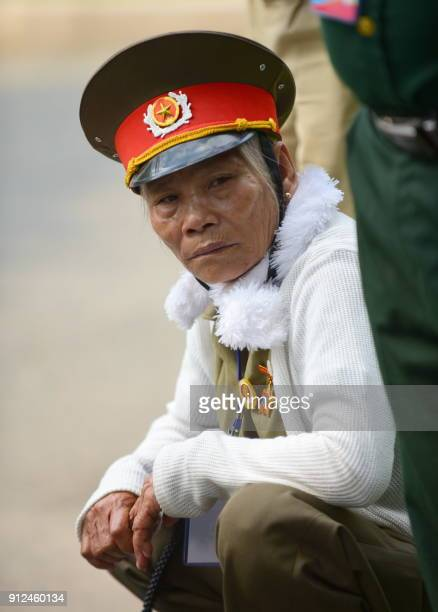A Tet Offensive veteran rests as she attends a ceremony marking the 50th anniversary of the military assault in Ho Chi Minh City on January 31 2018...