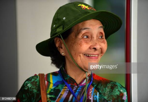 A Tet Offensive veteran wearing a Vietcong style hat arrives to attend a ceremony marking the 50th anniversary of the military assault in Ho Chi Minh...