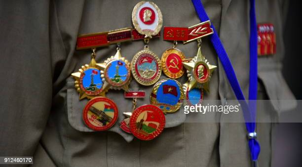 A Tet Offensive veteran wearing official decorations on his vest attends a ceremony marking the 50th anniversary of the military assault in Ho Chi...