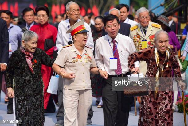 Tet Offensive veterans arrive to attend a ceremony marking the 50th anniversary of the military assault in Ho Chi Minh City on January 31 2018...