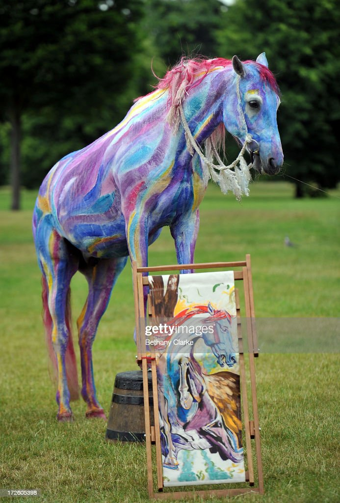 Teta, a horse painted to match the painting 'Pegasus' by Ronnie Wood, poses with a deckchair designed by the musician, in Hyde Park on July 4, 2013 in London, England. Ronnie Wood's 'Pegasus' design is part of Deckchair Dreams 2013, a public art initiative by the Royal Parks Foundation.