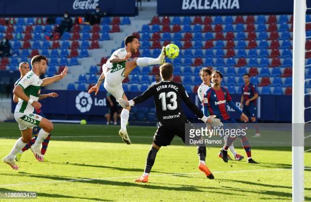 Tete Morente of Elche CF scores his team's first goal during the La Liga Santander match between Levante UD and Elche CF at Ciutat de Valencia...