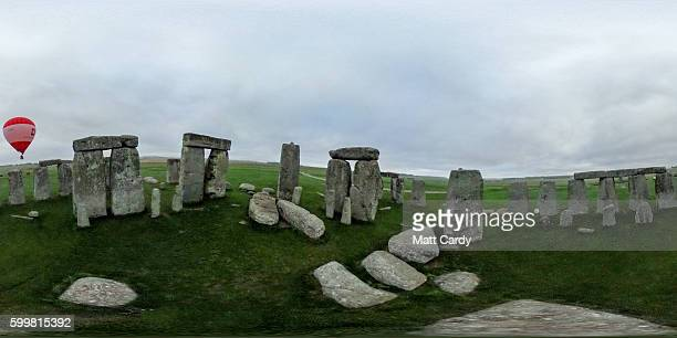 A tethered hot air balloon flies over the ancient neolithic monument of Stonehenge near Amesbury on September 7 2016 in Wiltshire England To mark the...