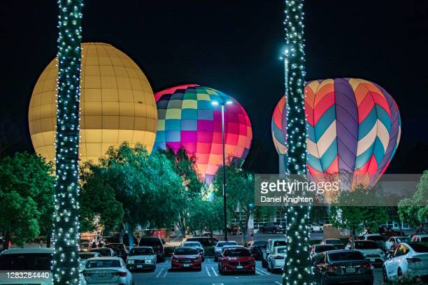 Tethered hot air balloons are illuminated by their burners at the Hot Air Halloween Balloon Glow on October 31, 2020 in Temecula, California. As the...