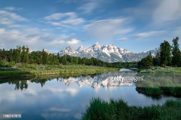 teton reflections - snowcapped mountain stock pictures, royalty-free photos & images