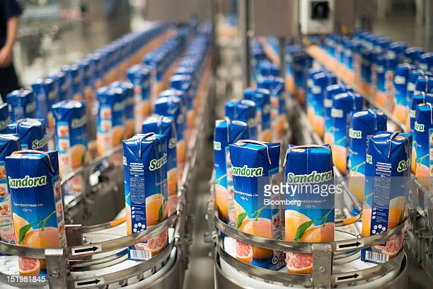 Tetra Pak cartons of Sandorabrand grapefruit juice move along the production line at PepsiCo Inc's Sandora beverage plant in Nikolaev Ukraine on...