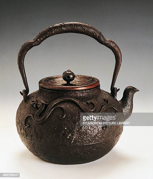 Tetsubin tea pot 19th century cast iron with handle with relief application depicting a stylized dragon height 208 cm Japanese civilisation EdoMeiji...