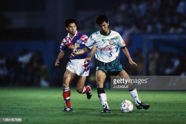 Tetsuji Hashiratani of Verdy Kawasaki controls the ball under pressure of Kazushi Kimura of Yokohama Marinos during the JLeague Suntory Series match...