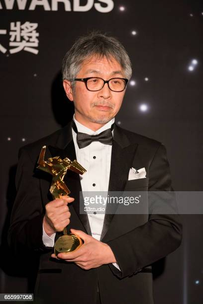 Tetsuo Ohya winner of the Best Visual Effects award for 'Shin Godzilla' poses with the award during the 11th Asian Film Awards on March 21 2017 at...