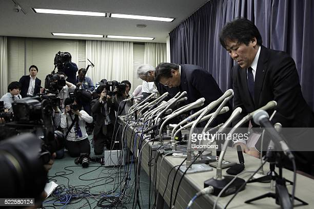 Tetsuro Aikawa president and chief operating officer of Mitsubishi Motors Corp second right bows with Ryugo Nakao executive vice president of...