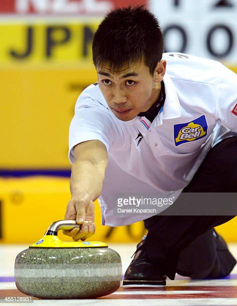 Tetsuro Shimizu of Japan throws a rock during the Olympic Qualification Tournament match between Japan and Italy on December 11 2013 in Fussen Germany