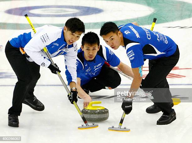Tetsuro Shimizu of Team Karuizawa delivers the stone in the third place match against a Canadian team during day four of the Karuizawa International...