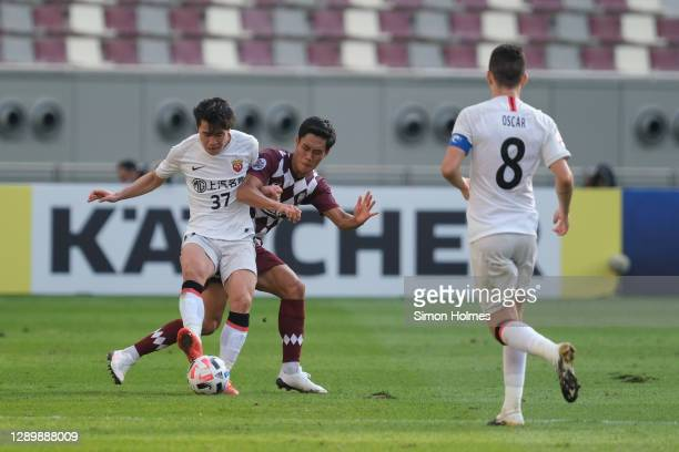 Tetsushi Yamakawa of Vissel Kobe challenges Shanghai SIPG's Chen Binbin during the AFC Champions League Round of 16 match between Vissel Kobe and...