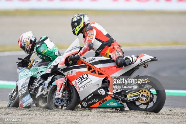 Tetsuta Nagashima of Japan and Onexox TKKR Sag Team and Lukas Tulovic of Germany and Kiefer Racing crashed out during the Moto2 race during the...