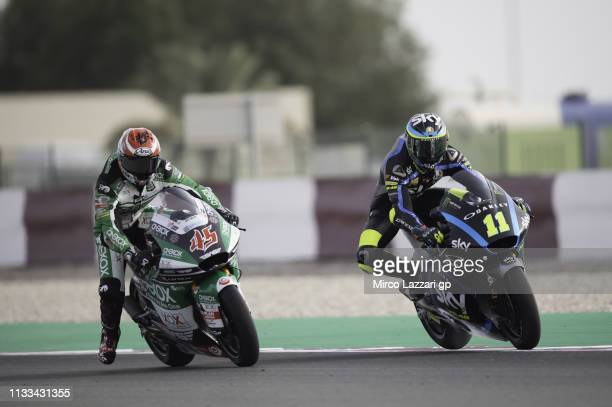 Tetsuta Nagashima of Japan and Onexox TKKR Sag Team and Niccolo Bulega of Italy and Sky Racing Team VR46 head down a straight during the Moto2 &...