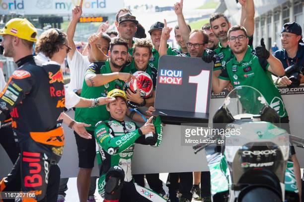 Tetsuta Nagashima of Japan and Onexox TKKR Sag Team celebrates with team the Moto2 pole position during the MotoGp of Austria - Qualifying at Red...
