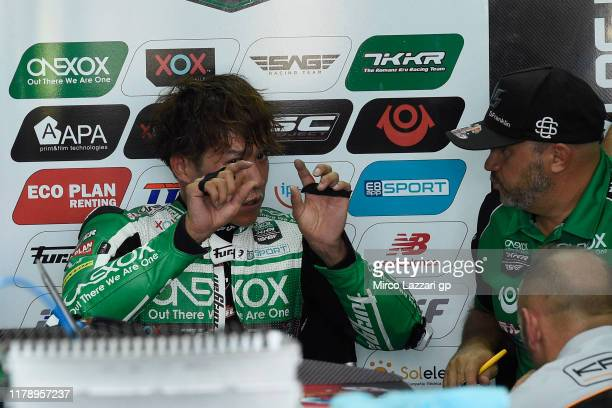 Tetsuta Nagashima of Japan and Onexox TKKR Sag Team speaks with mechanics in box during the MotoGP of Thailand - Free Practice on October 04, 2019 in...