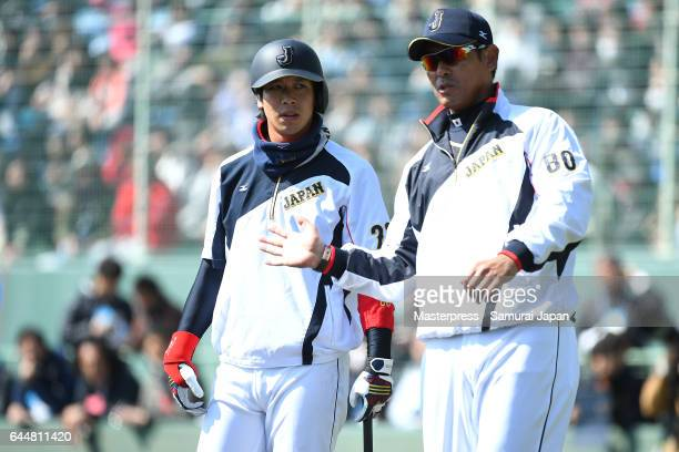 Tetsuto Yamada and Atsunori Inaba of Japan talk during SAMURAI JAPAN's training camp at the Sun Marine Stadium Miyazaki on February 24 2017 in...