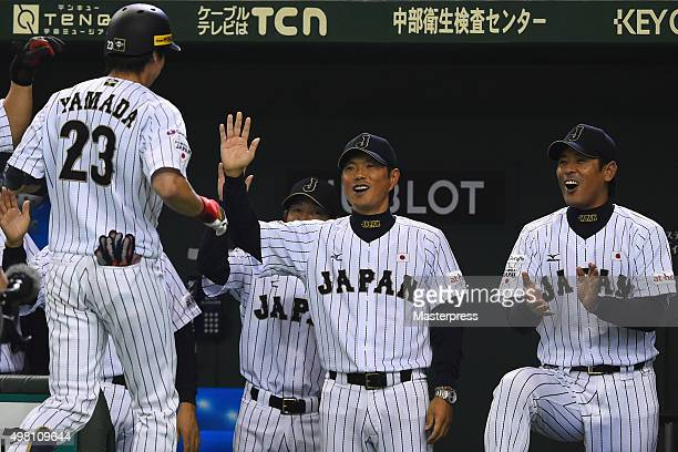 Tetsuto Yamada of Japan celebrates his homer with Hiroki Kokubo of Japan after scoring in the bottom half of the first inning during the WBSC Premier...