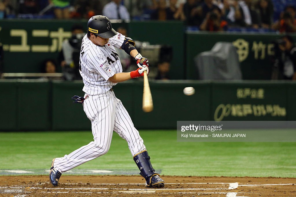 Tetsuto Yamada #23 of Japan hits a homer in the bottom half of the first inning during the WBSC Premier 12 third place play off match between Japan and Mexico at the Tokyo Dome on November 21, 2015 in Tokyo, Japan.