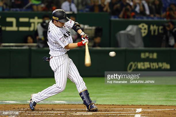 Tetsuto Yamada of Japan hits a homer in the bottom half of the first inning during the WBSC Premier 12 third place play off match between Japan and...