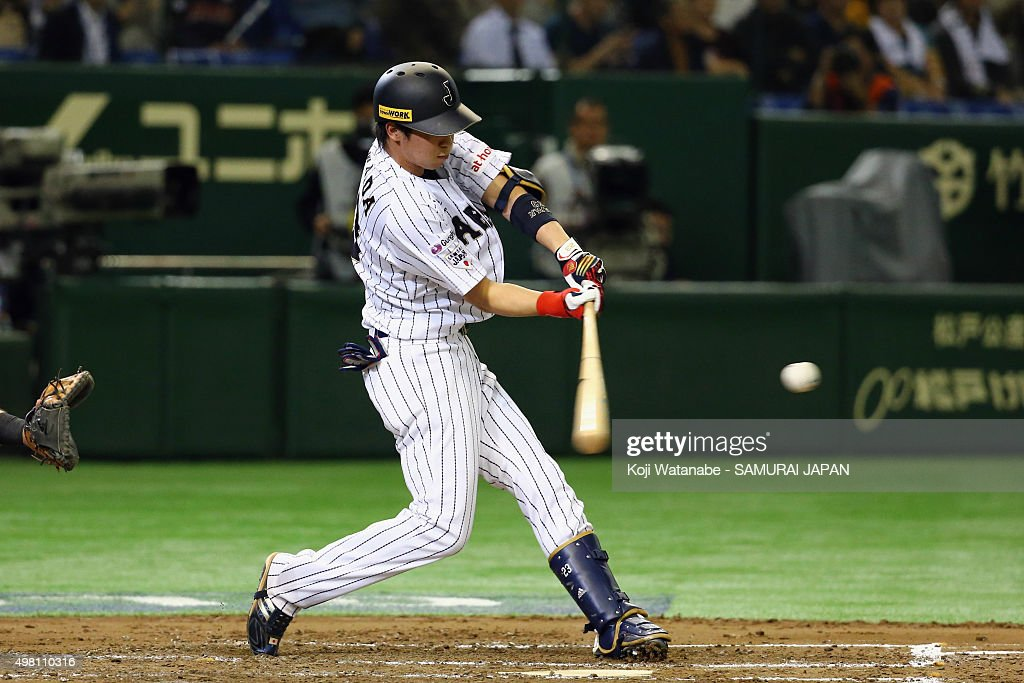Tetsuto Yamada #23 of Japan hits a two-run home-run in the bottom half of the second inning during the WBSC Premier 12 third place play off match between Japan and Mexico at the Tokyo Dome on November 21, 2015 in Tokyo, Japan.