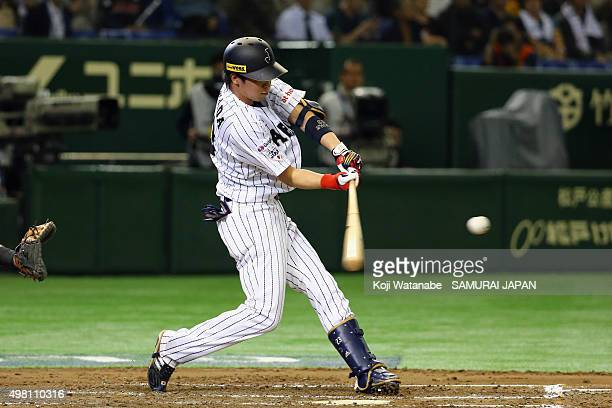 Tetsuto Yamada of Japan hits a tworun homerun in the bottom half of the second inning during the WBSC Premier 12 third place play off match between...