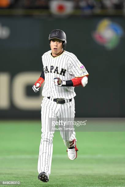 Tetsuto Yamada of Japan runs after hitting a RBI double in the fourth inning of the World Baseball Classic Pool B Game One between Cuba and Japan at...