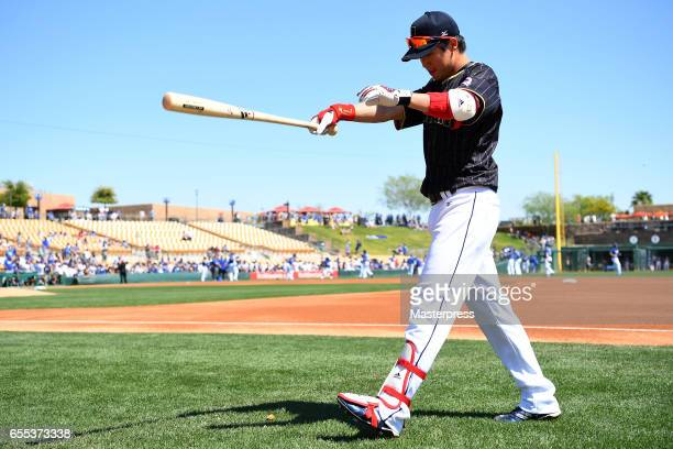 Tetsuto Yamada of Japan warms up prior to the exhibition game between Japan and Los Angeles Dodgers at Camelback Ranch on March 19 2017 in Glendale...