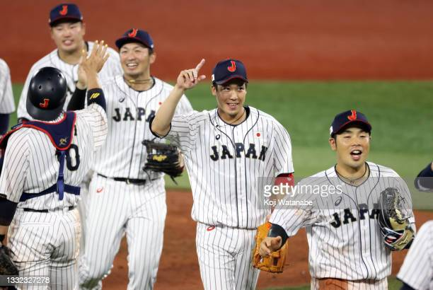 Tetsuto Yamada of Team Japan celebrates with his teammates after defeating Team Republic of Korea 5-2 during the semifinals of men's baseball on day...
