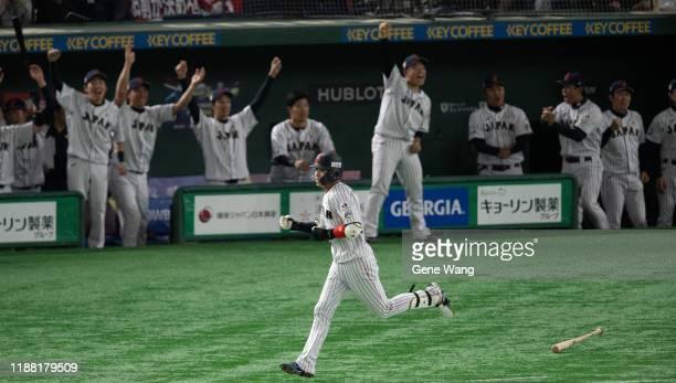 Tetsuto Yamada of team Japan hit a three run homrun during the WBSC Premier 12 final game between Japan and South Korea at the Tokyo Dome on November...