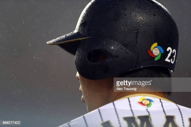 Tetsuto Yamada of Team Japan is seen in the rain during Game 2 of the Championship Round of the 2017 World Baseball Classic against Team USA on...