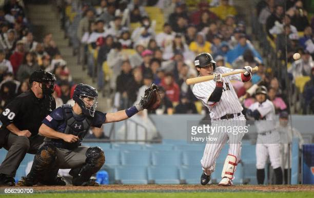 Tetsuto Yamada of team Japan makes a sacrifice bunt to advance the runner in the eighth inning against team United States during Game 2 of the...