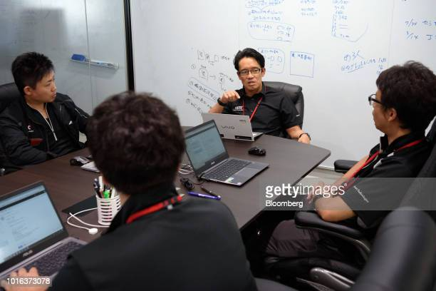 Tetsuya Kimura president of Asahi Tekko Co and iSmart Technologies Corp second right holds a meeting with employees at the iSmart Technologies office...