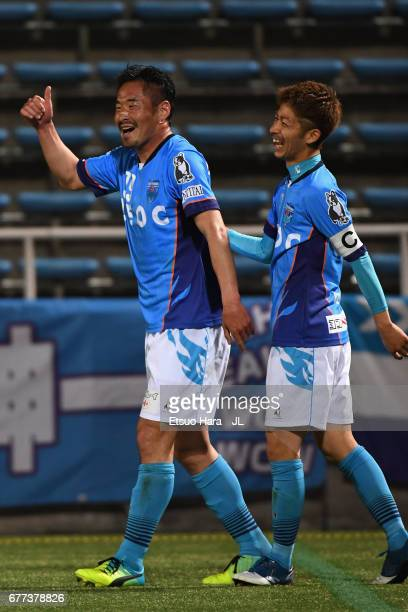 Tetsuya Okubo of Yokohama FC celebrates scoring his side's fourth goal with his team mate Kensuke Sato during the JLeague J2 match between Yokohama...
