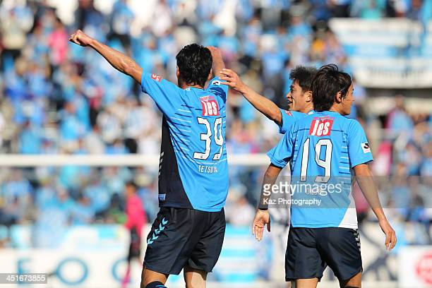Tetsuya Okubo of Yokohama FC is congratulated by Kazuyoshi Miura on assisting their team's second goal during the JLeague second division match...