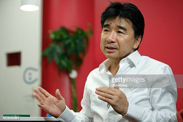 Tetsuya Sanada president and chief executive officer of KLab Inc gestures as he speaks during an interview at the company's headquarters in Tokyo...