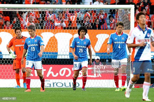 Tetusya Enomoto Yuzo kobayashi Shunsuke Nakamura and Yuzo Kurihara of Yokohama FMarinos react after conceding the first goal during the JLeague match...