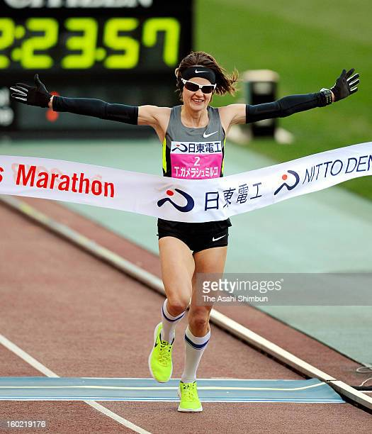Tetyana GameraShmyrko of Ukraine celebrates winning the 32nd Osaka International Women's Marathon at Nagai Stadium on January 27 2013 in Osaka Japan