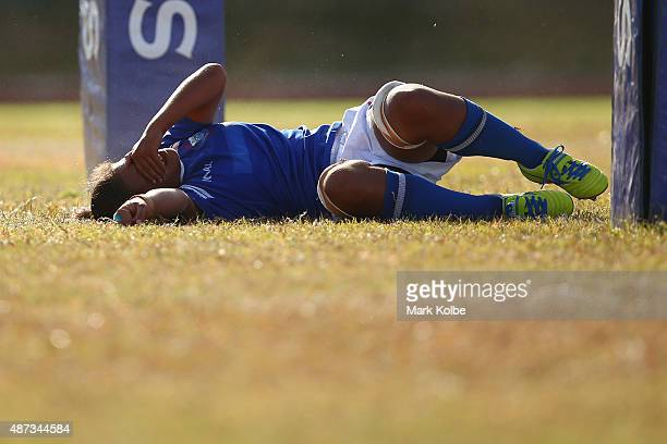 Teuila Aukusitino of Samoa looks dejected after a Fiji try during the girls match between Samoa and Fji in the rugby sevens competition at the Apia...