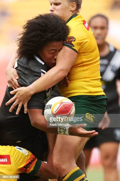 Teuila FotuMoala of the Ferns is tackled during the 2017 Rugby League Women's World Cup Final between Australia and New Zealand at Suncorp Stadium on...