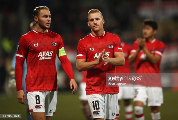 Teun Koopmeiners and Dani de Wit of AZ Alkmaar applaud fans following the UEFA Europa League group L match between AZ Alkmaar and Manchester United...