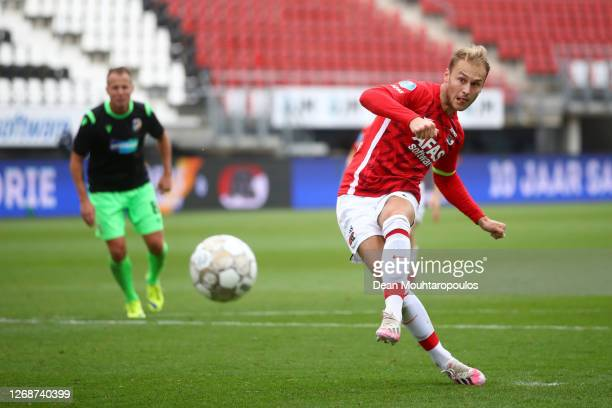 Teun Koopmeiners of Alkmaar Zaanstreek scores his team's first goal from the penalty spot during the UEFA Champions League qualification match...
