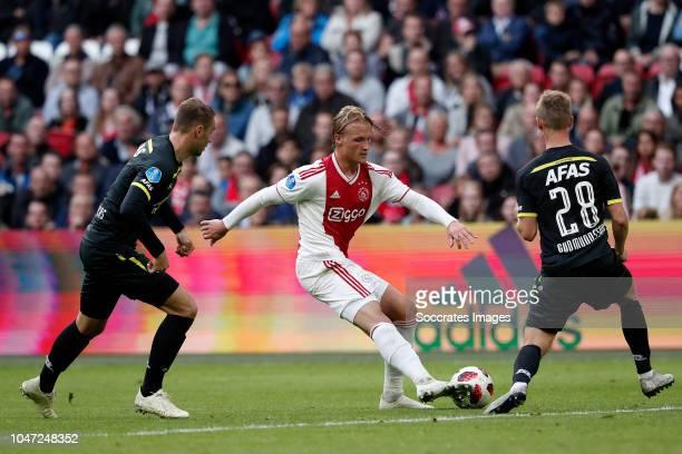 Teun Koopmeiners of AZ Alkmaar Kasper Dolberg of Ajax Albert Gudmundsson of AZ Alkmaar during the Dutch Eredivisie match between Ajax v AZ Alkmaar at...
