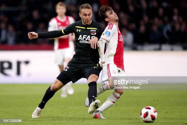 Teun Koopmeiners of AZ Alkmaar Nicolas Tagliafico of Ajax during the Dutch Eredivisie match between Ajax v AZ Alkmaar at the Johan Cruijff Arena on...