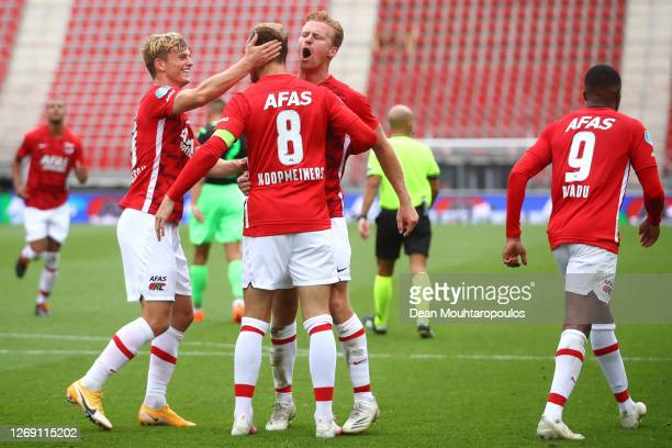 Teun Koopmeiners of AZ celebrates with teammates after scoring his team's first goal during the UEFA Champions League qualification match between AZ...