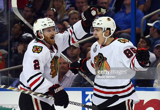 Teuvo Teravainen celebrates his third period goal with Duncan Keith of the Chicago Blackhawks against the Tampa Bay Lightning during Game One of the...