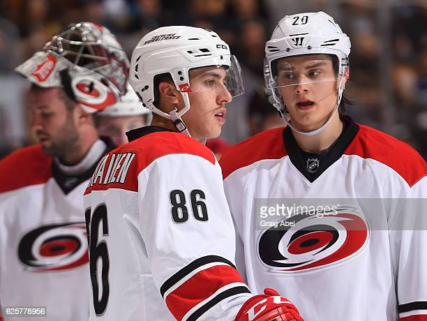 Teuvo Teravainen of the Carolina Hurricanes and teammate Sebastian Aho talk during the second period against the Toronto Maple Leafs at the Air...